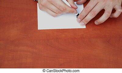 Handwritten words Thanks a lot on white paper sheet