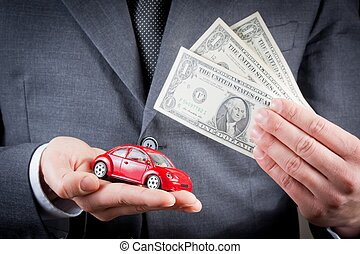 toy car and dollars in the hands of business man concept for...