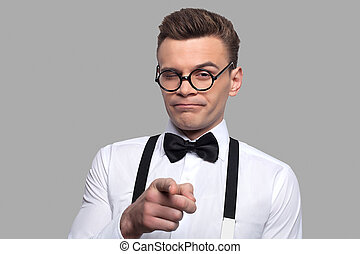 I choose you! Portrait of young nerd man in bow tie and...