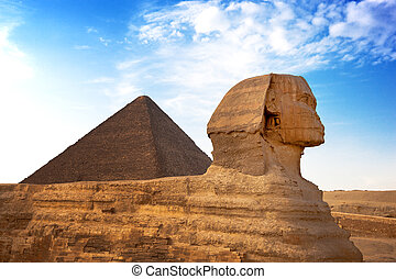 Sphinx and Pyramid Giza, Egypt. The Great Pyramid of Giza is...