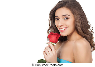Beauty with flower. Attractive young woman holding a red...