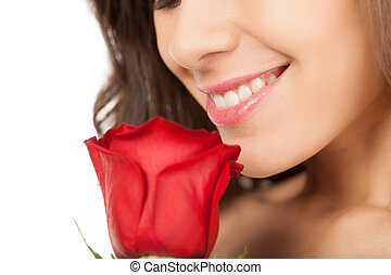Beauty with rose. Cropped image of beautiful young woman...