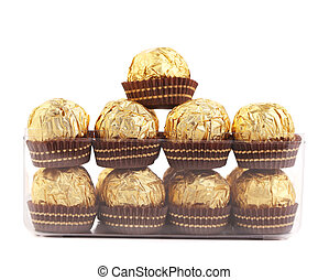 Two rows of chocolate bonbons in box.