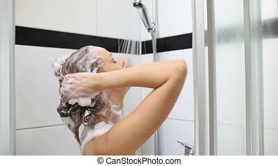 Pretty, young woman taking a shower - Young woman taking a...