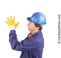 Worker putting on rubber glove. Isolated on a white...