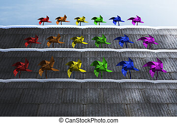 Pinwheels on the stairs that is made of concrete and with...