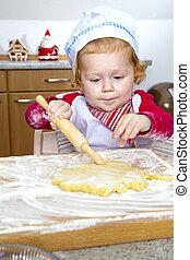 Christmas Bakery - Little girl is baking for christmas in...