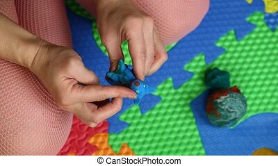 Woman's hands with plasticine