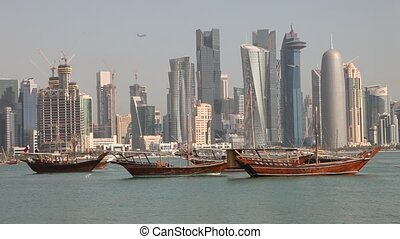 Doha skyline. Qatar - Traditional arabic dhows in Doha....