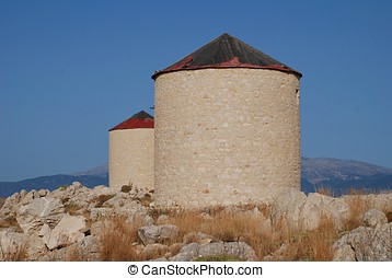 Stone windmills, Halki - Two old stone windmills on the...