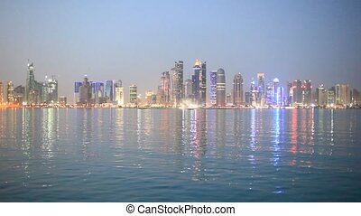 Doha skyline at dusk, Qatar - Doha downtown skyline at dusk,...