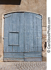 Old wooden barn door in rural vilage