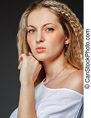 Portrait of the beauty young blond woman with make up