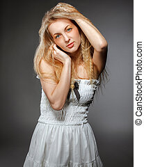 Portrait of the beauty young blond woman