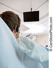Patient Watching TV During Dialysis - Rear view of patient...