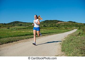Jogging in nature - Beautiful teenage girl jogging in nature...