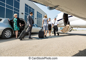 Business People About To Board Private Jet