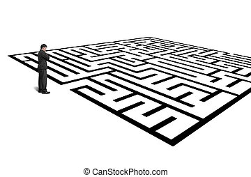 Businessman standing in front of maze isolated in white...