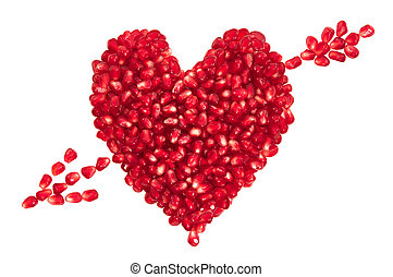 Heart and arrow - Pomegranate seeds in heart shape with...
