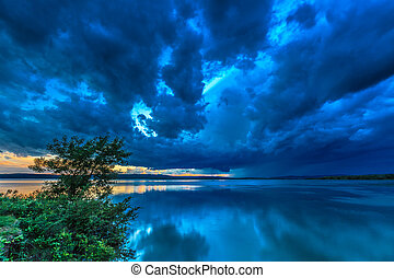 dark storm clouds on evening sky. Danube River, Romania