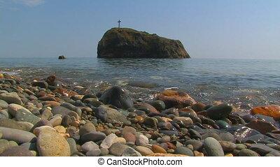 Cross on the top of the island Cape Fiolent, Crimea, Ukraine...