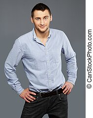 Handsome young man in a blue shirt