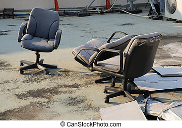 Various damaged office equipment waiting for scrapping.