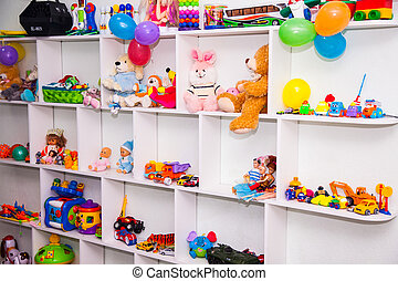 cupboard with toys in nursery