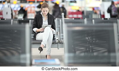Businesswoman waiting for flight - Pretty, young...