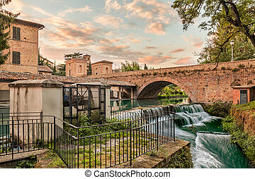 view of Bevagna, Umbria, Italy, with bridge, canal of the...