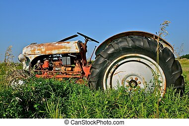 Old tractor Parked in the Grass - An old retired tractor...