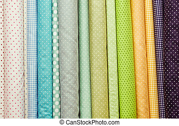 Fabric colours - Rolls of colorful fabric as a vibrant...