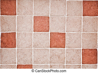 Kitchen tiles - Orange and beige kitchen tiles as a...