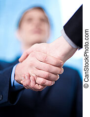 Business handshake among two corporates - The deal is...