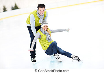 Ice skating - A picture of a young couple ice-skating on a...