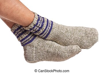 Knitted socks - Legs of caucasian man in knitted warm socks...