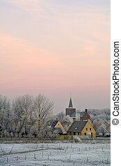 Winter dawn on Ellewoutsdijk, the Netherlands - The winter...