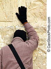 Jewish worshiper prays at the Wailing Wall an important...