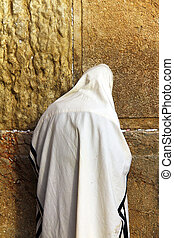 Jewish worshiper prays at the Wailing Wall - Jewish...