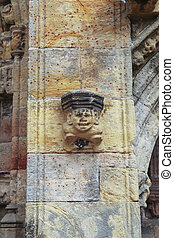 Figure on antique wall in Scotland - Laughing figure on wall...