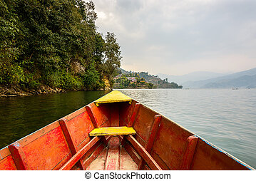 Barque on Phewa Lake in Pokhara, Nepal