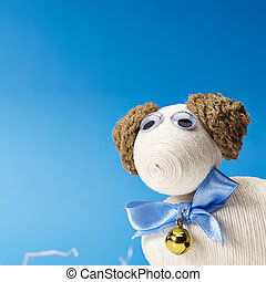 Easter lamb with blue bow and gold bell on the blue...