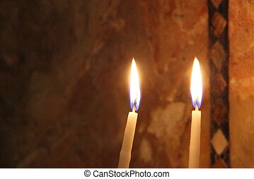Two burning candles in the church