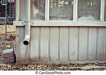 Drain pipe - A metal drainpipe on a garden shed