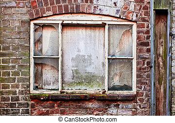 Broken window - A broken window in a brick wall
