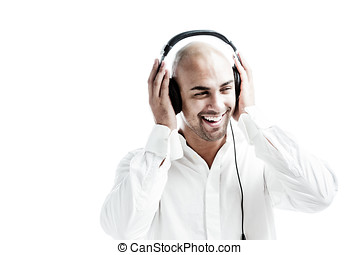 Young man listening to music and puts his hands at the...