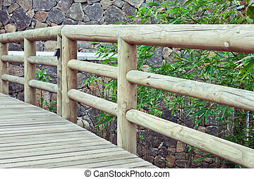 Wooden bridge - Rainings of a wooden bridge in a landscaped...