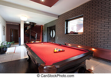 Red pool table - A big red pool table in a luxurious...