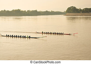 NONGKHAI,THAILAND-OCT 20:Traditional Thai long boats compete...