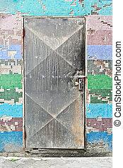 Locked door - Locked metallic door in a colorful tiled wall